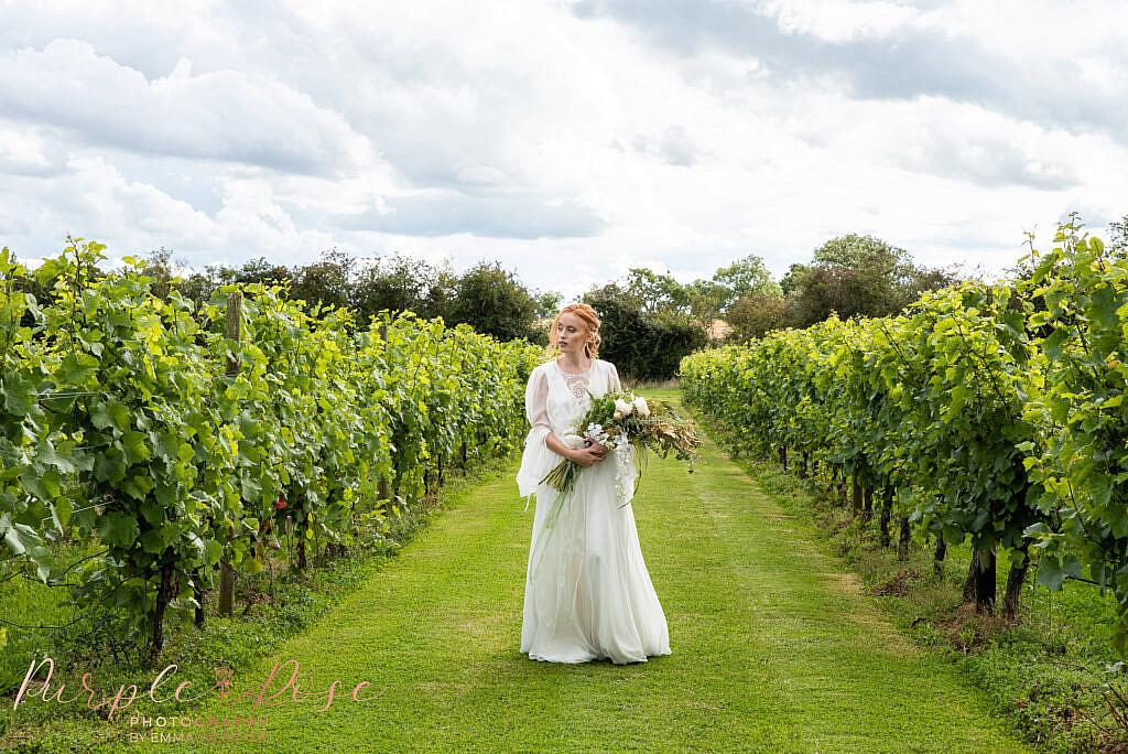 Bride walking with flowers