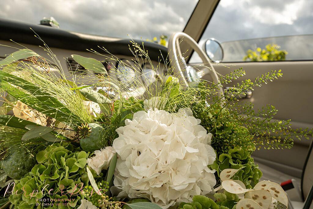 Wedding bouquet in a vintage car