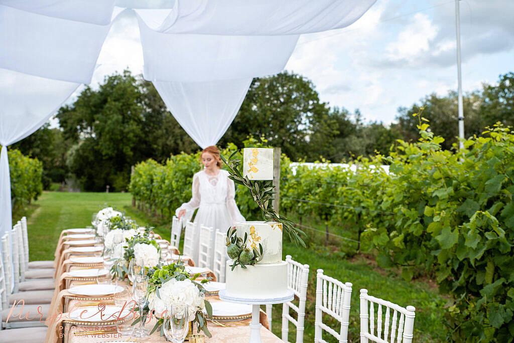 Bride looking at wedding reception set up