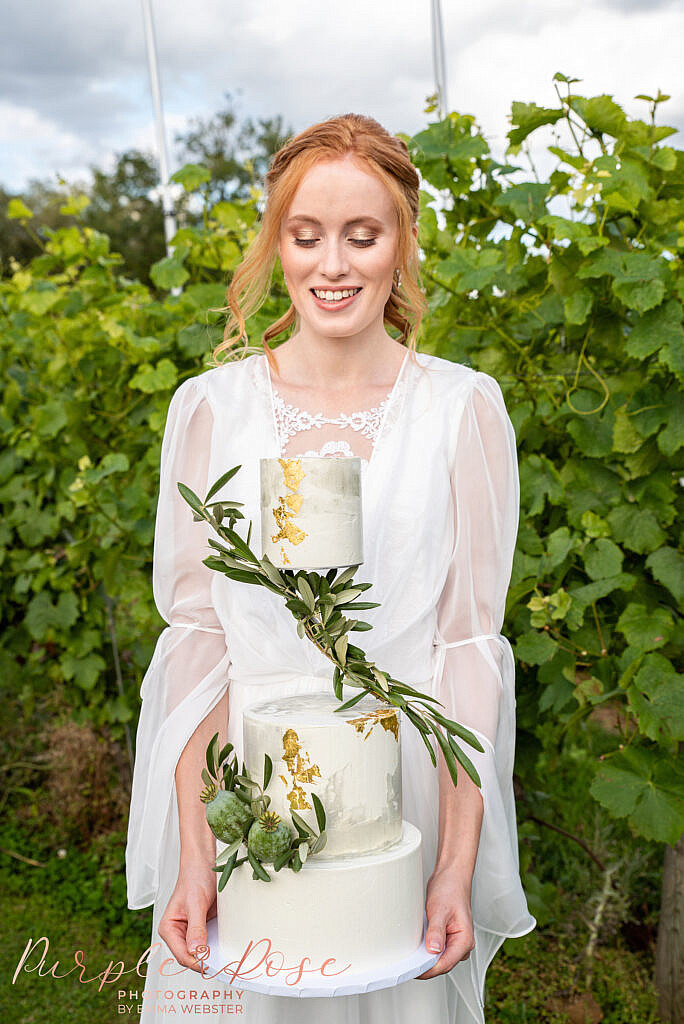 Bride holding her wedding cake