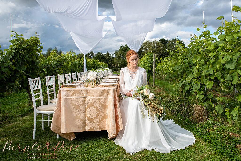 Bride sat holding her bouquet