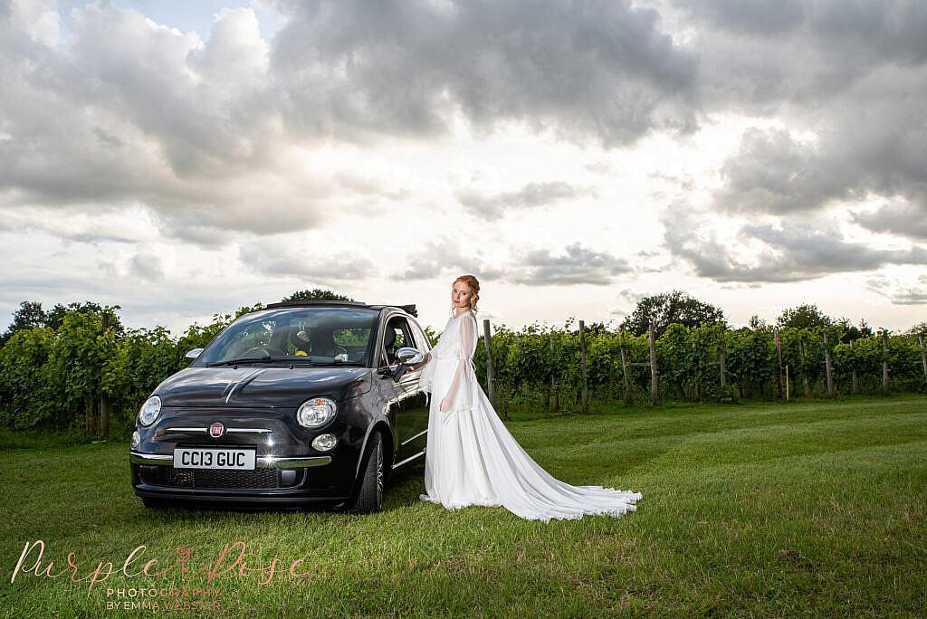 Bride stood by car