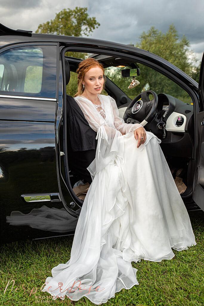 Bride sat in car