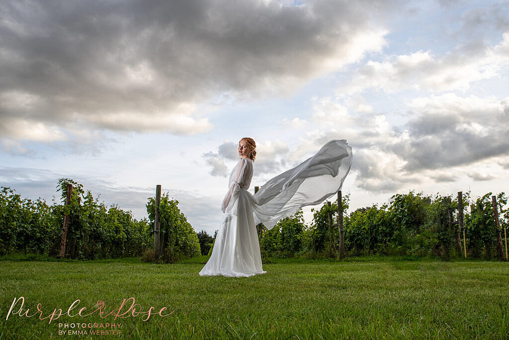 Bride in front of dramatic sky