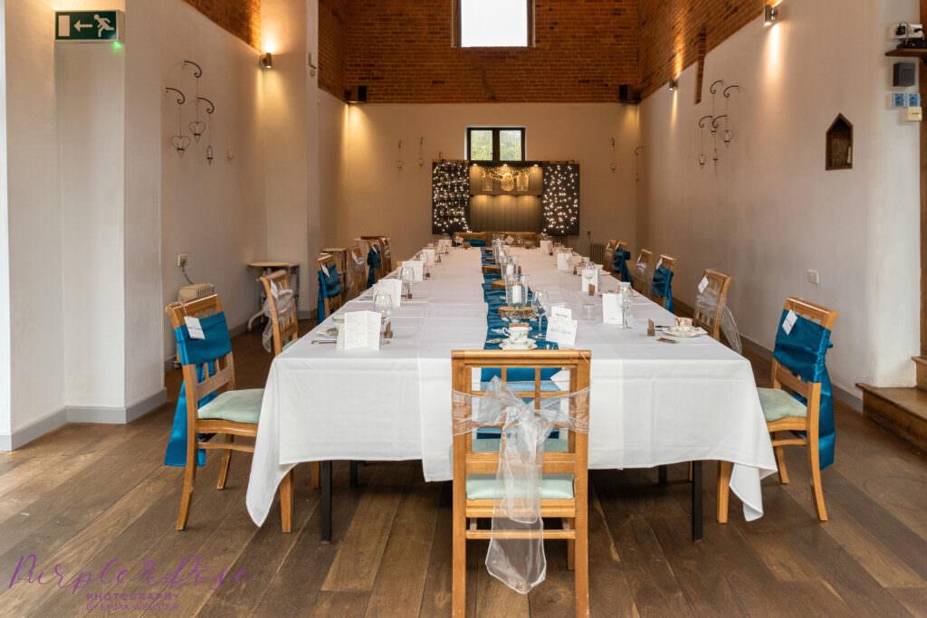Wedding barn set up for reception meal