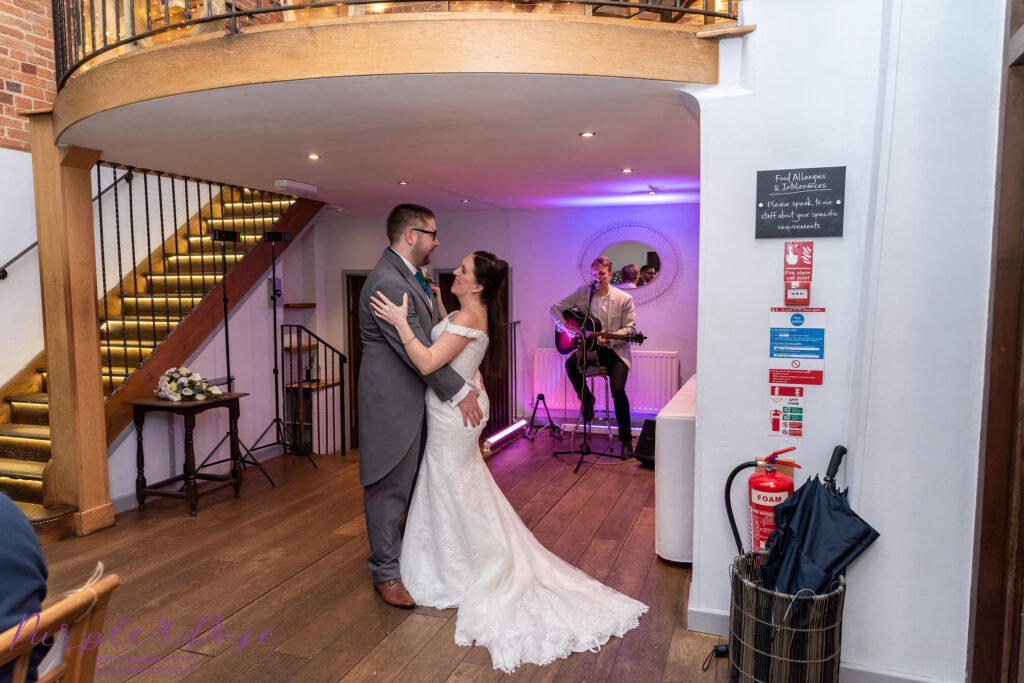 Bride and groom enjoying their 1st dance