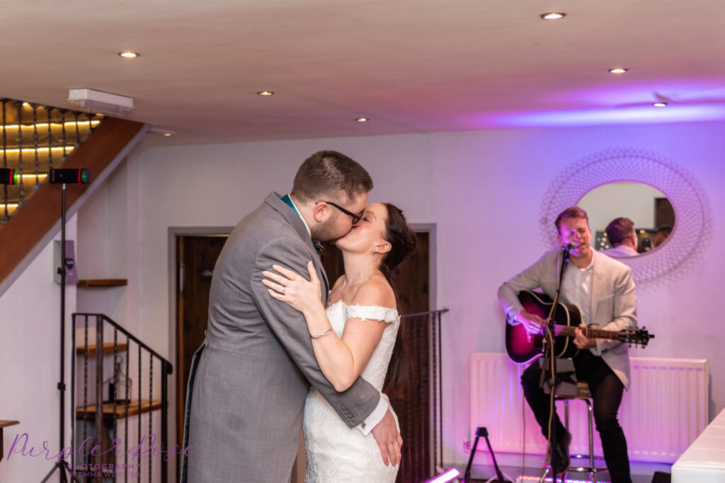 Bride and groom kissing during their 1st dance