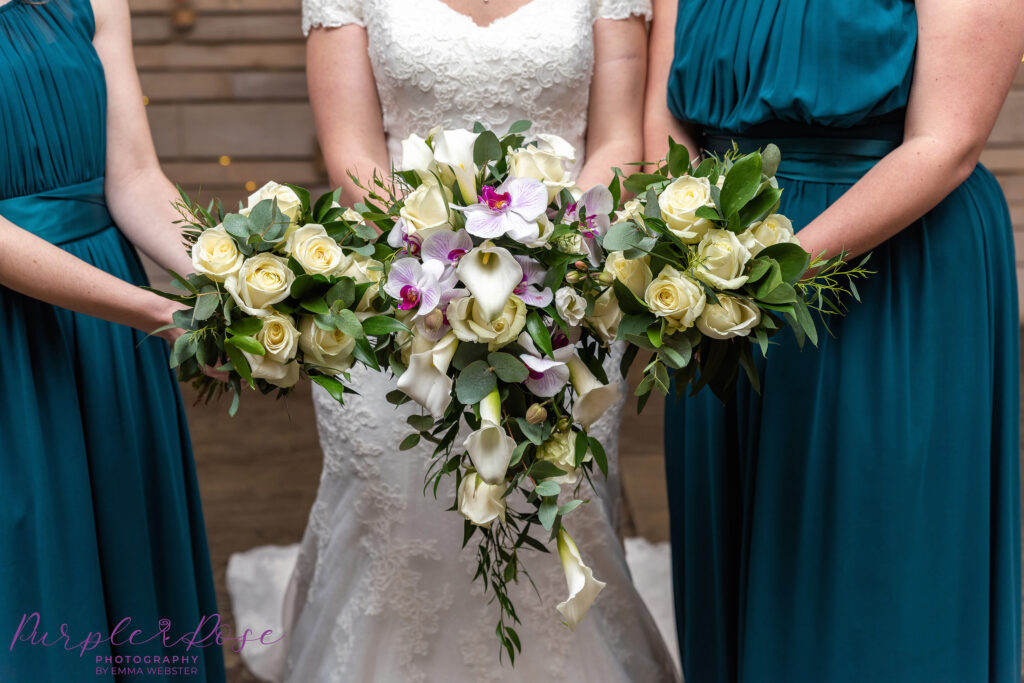 Bridal party holding thier bouquets