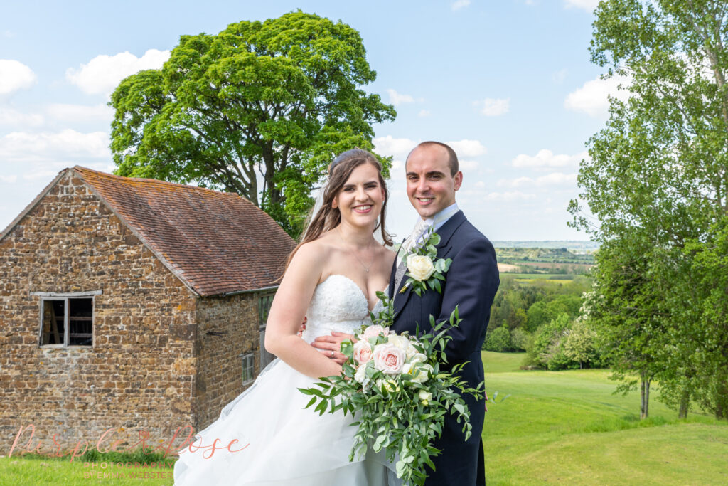 Couple by a barn at Hellidon lakes