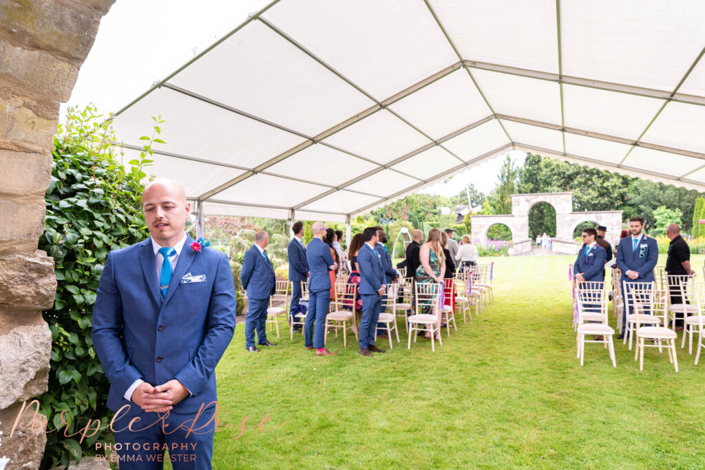 Groom under a canopy waiting for his bride to arrive