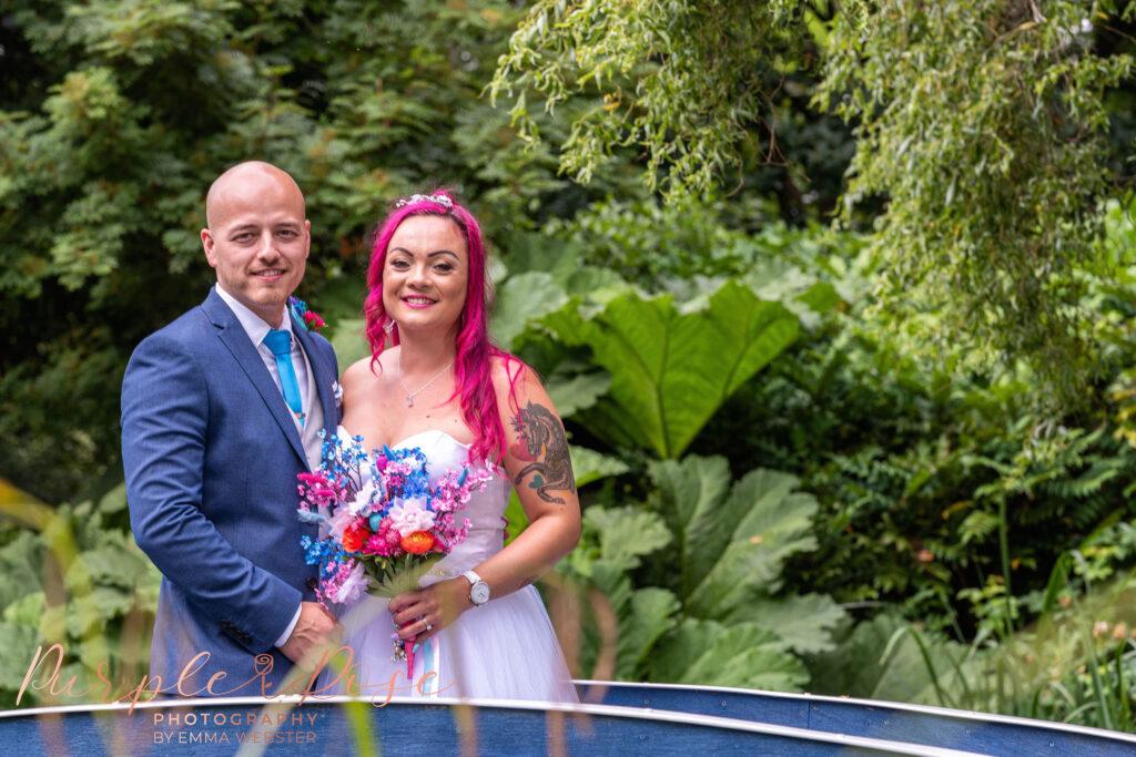 Bride and groom on a blue bridge