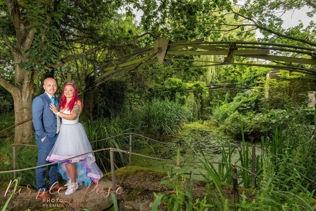 Bride and groom stood in Flaxbourne gardens